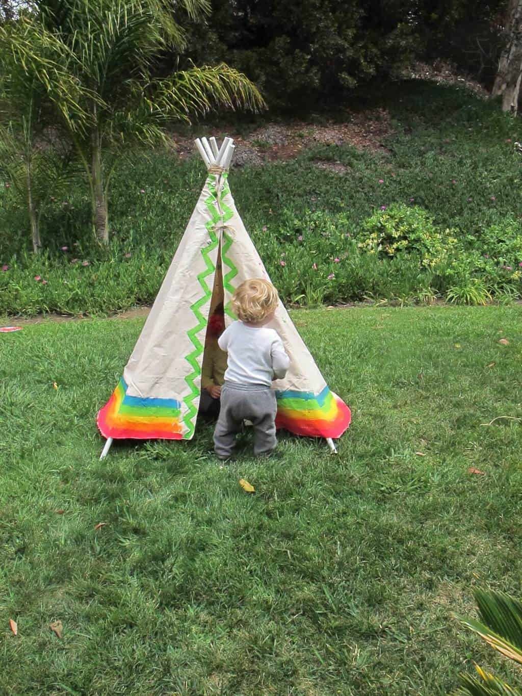 Kid in front of kids play teepee
