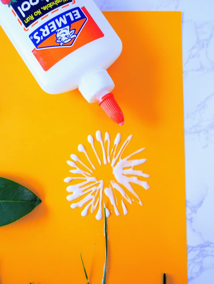 Add glue to paper in a firecracker formation
