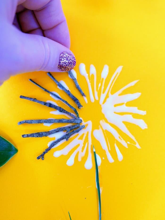 Add each twig to the glue