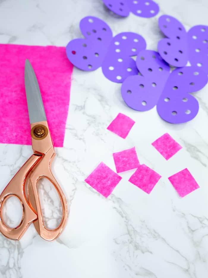 Cut up small squares of tissue paper.
