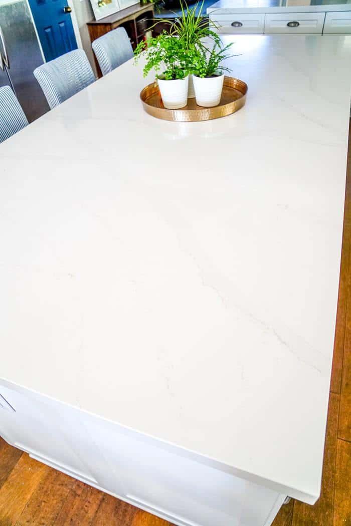White Quartz Countertops with slight veining. Kitchen renovation. Classic White Kitchen, Modern Farmhouse Style Kitchen. All White Kitchen.