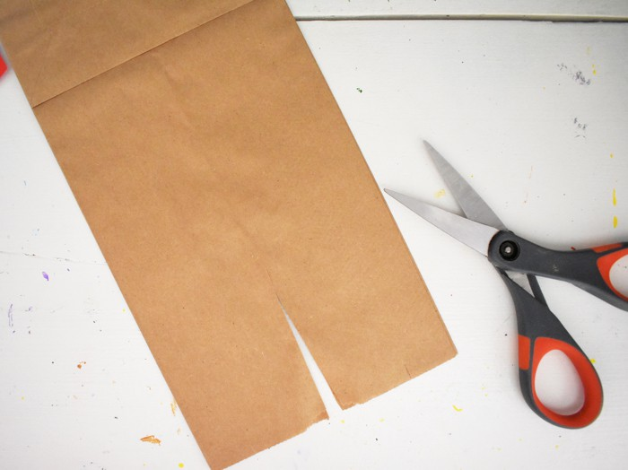 Cut a slit in the center bottom of the bag.