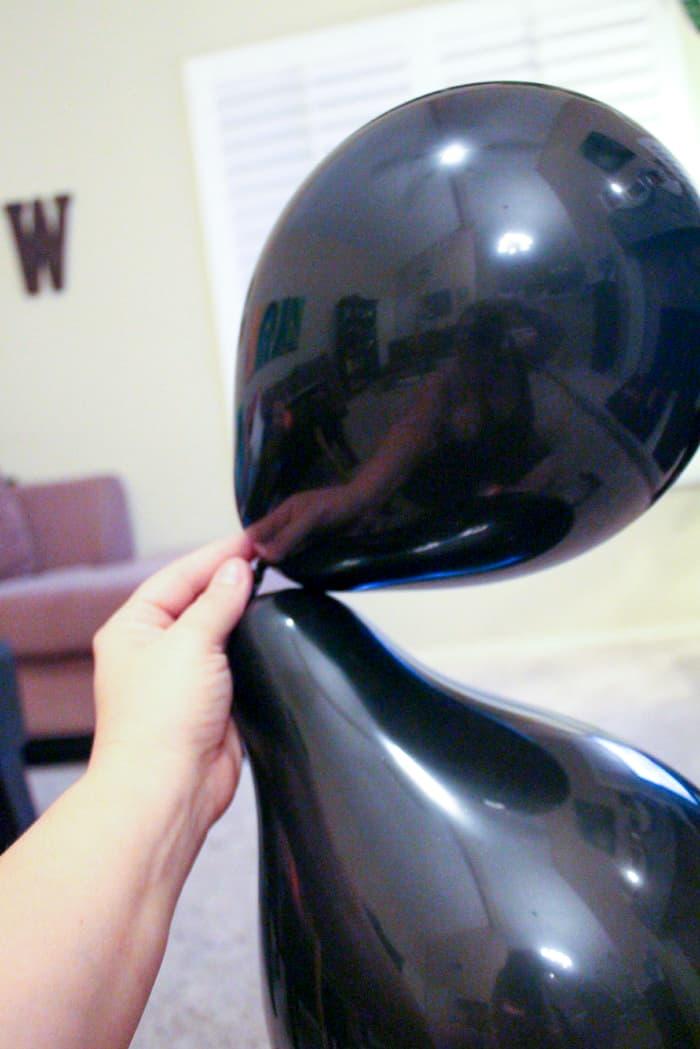 two round black balloons