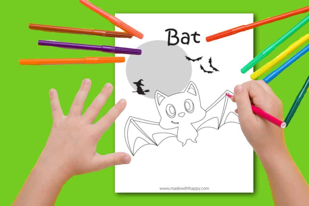 Child coloring a bat coloring page