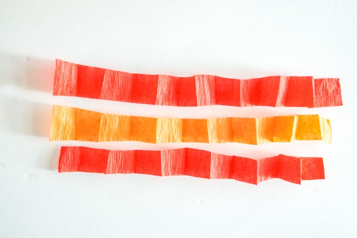 three thin pieces of crepe paper folded