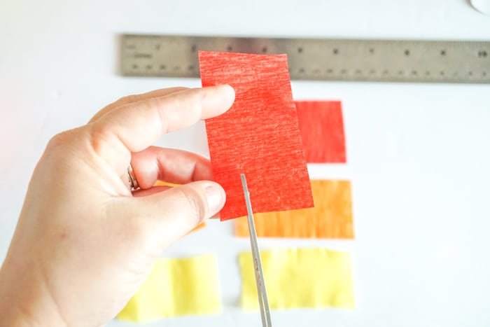 cutting a the edge of crepe paper