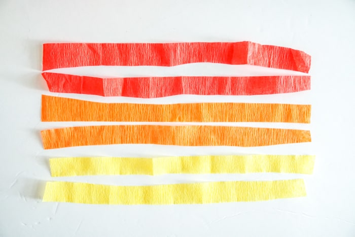 red, orange and yellow crepe paper cut in half