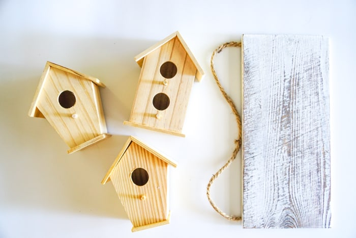 Wooden Birdhouses and White Plank