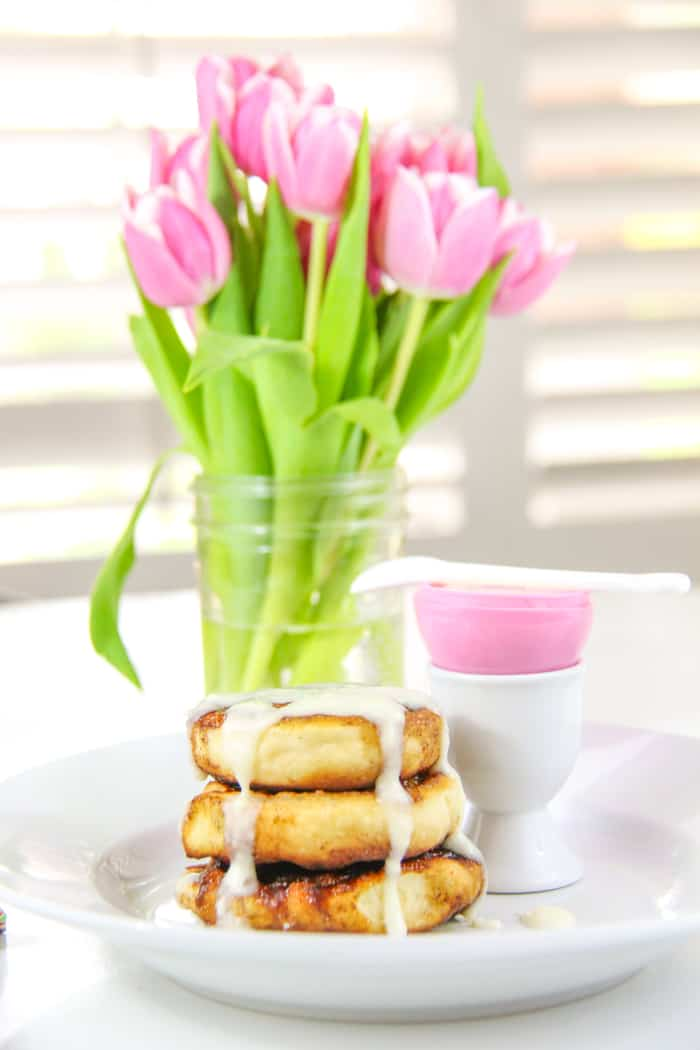 Pink Tulips and a plate of cinnamon rolls