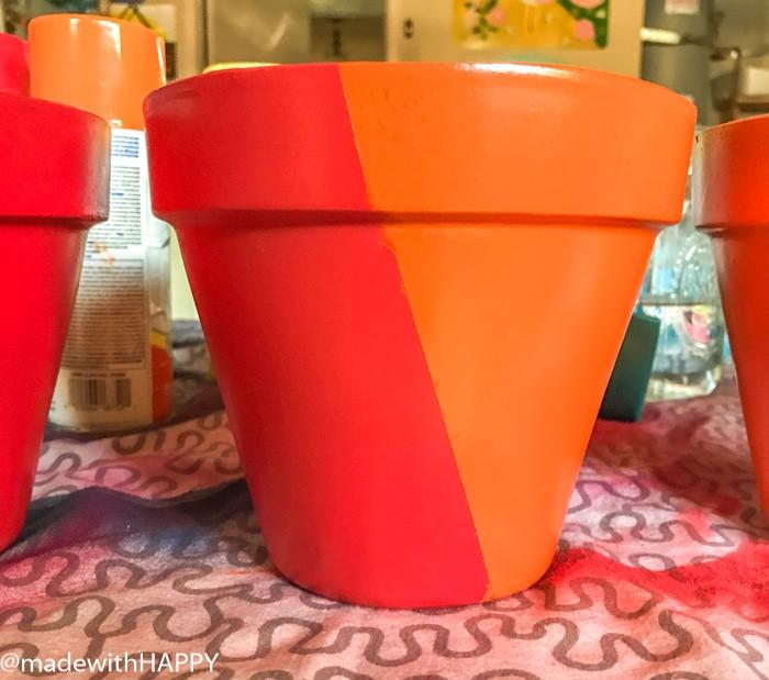 Colorblocking Terra Cotta Pots. Painting Pots Color Blocking Flower Pots. Rainbow Vertical Garden. Colorful garden pots brighten up any outside space.