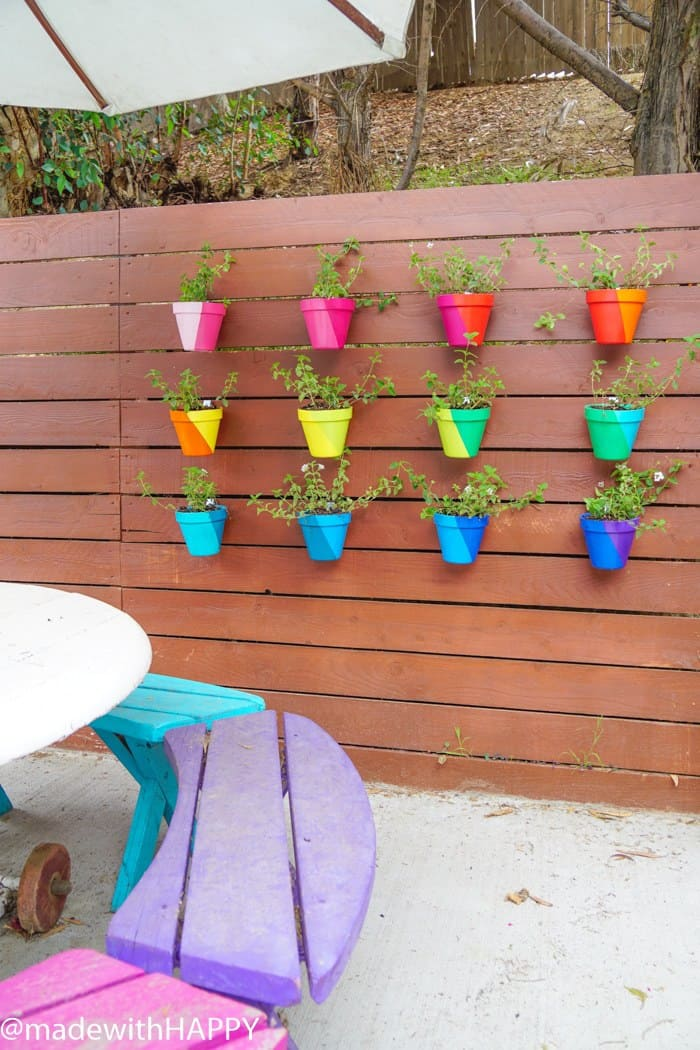 Color Blocking Flower Pots. Rainbow Vertical Garden. Colorful garden pots brighten up any outside space.