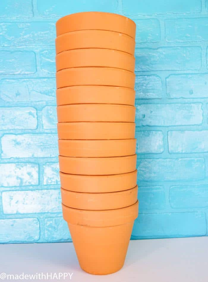 Stack of Terra Cotta Pots. Color Blocking Flower Pots. Rainbow Vertical Garden. Colorful garden pots brighten up any outside space.