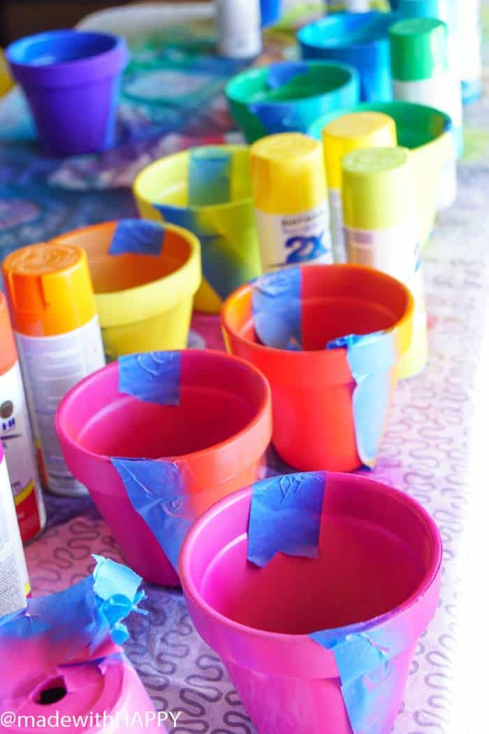 Rainbow Painted pots. Color Blocking Flower Pots. Rainbow Vertical Garden. Colorful garden pots brighten up any outside space.