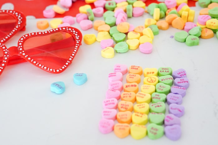 Heart shaped candies. Conversation Heart Glasses. Valentines Crafts with Kids. Kids Valentines Crafts. Heart Shaped Glasses Pink. Heart Shaped Glasses Red. Red Heart Shaped Glasses. Valentines Clothing.