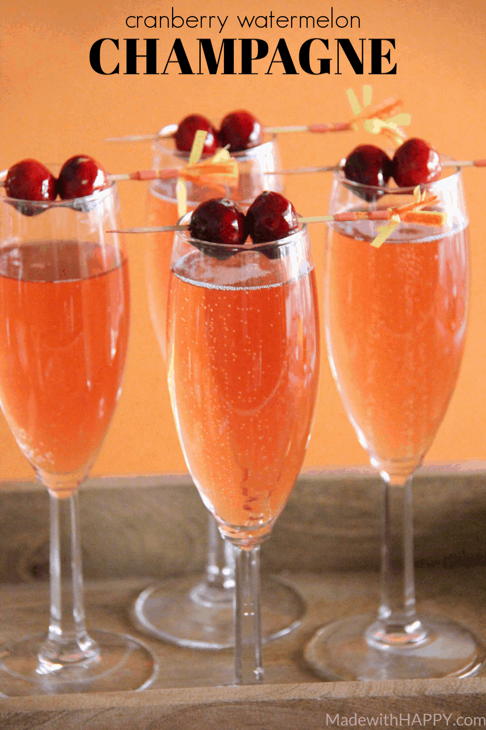 Fall Cocktail Idea. Cranberry Watermelon Champagne Cocktail | Holiday Cocktails | Cranberry Cocktails | Champagne Cocktails | www.madewithhappy.com