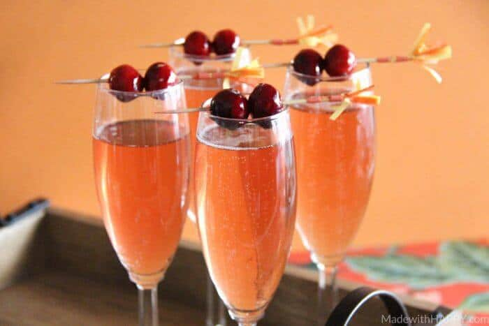 Cranberry Watermelon Champagne Cocktail   Holiday Cocktails   Cranberry Cocktails   Champagne Cocktails   www.madewithhappy.com   #MixedWithTrop #ad