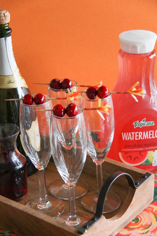 Cranberry Watermelon Champagne Cocktail | Holiday Cocktails | Cranberry Cocktails | Champagne Cocktails | www.madewithhappy.com