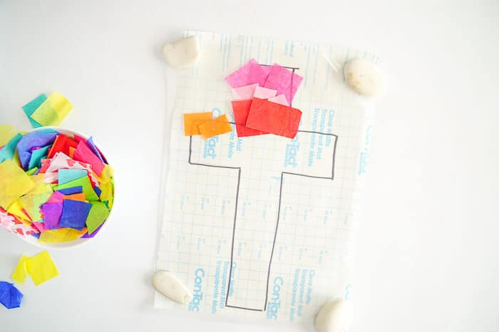 Fun Easy Kids Easter Crafts. This Easter Suncatcher Craft is perfect kids Easter craft. We're show you just how to make a suncatcher with tissue paper.