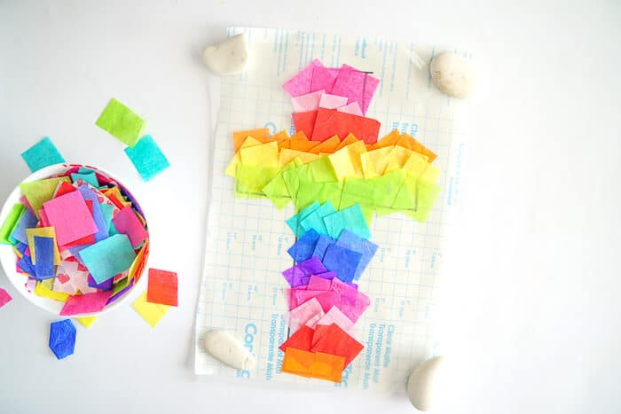 Easter Cross Craft. This Easter Suncatcher Craft is perfect kids Easter craft. We're show you just how to make a suncatcher with tissue paper.