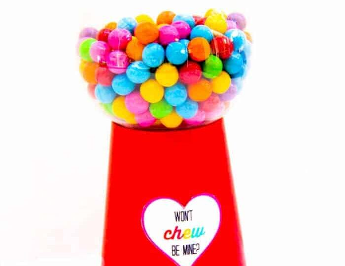 There are so many fun make your own Valentine option. We are in love with this DIY Gumball Machine with free printable.. We're sharing how to make a gumball machine along with these super cute