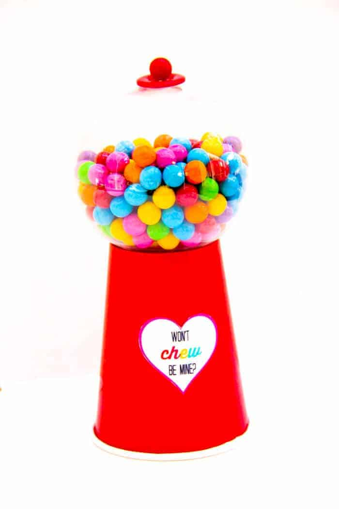 "There are so many fun make your own Valentine option.  We are in love with this DIY Gumball Machine with free printable.. We're sharing how to make a gumball machine along with these super cute ""won't chew be mine"" free printables. www.madewtihhappy.com"