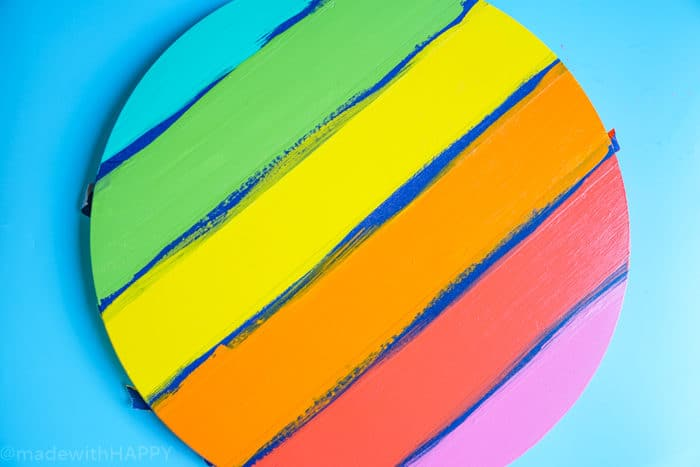 Rainbow painted wood with white. How to Make a Lazy Susan. DIY Home Decor with Rainbow Colors. Paint projects for the home. Rainbow accents around the house. DIY Home Decor with this lazy susan
