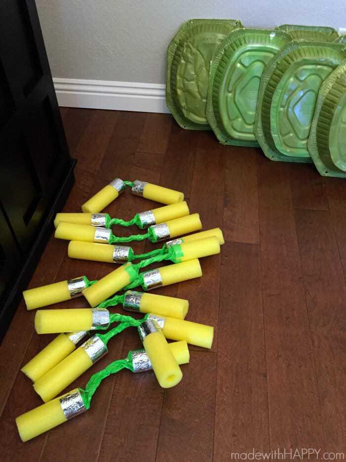 DIY Teenage Mutant Ninja Turtle Nunchucks | Teenage Mutant Ninja Turtle Party Ideas | TMNT Party Ideas | TMNT Shells | Pool Noodle Nunchucks | Ninja Turtle Cookies | www.madewithhappy.com
