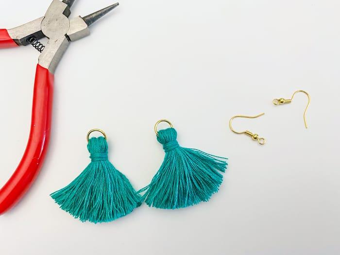 Add earing hooks to tassels