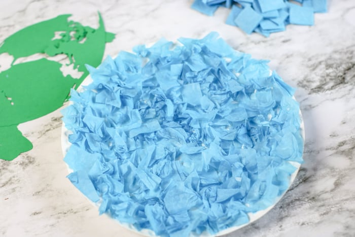 paper plate covered with blue tissue paper