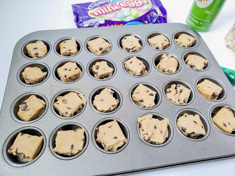 cookie dough in mini muffin tins