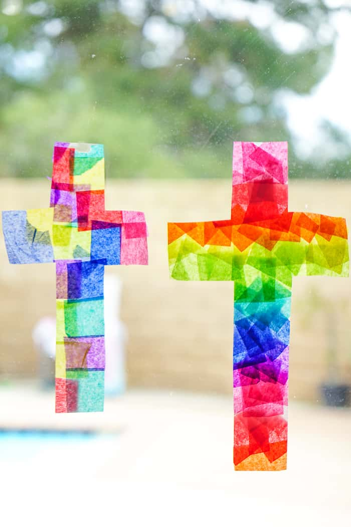 Cross Suncatcher craft. This Easter Suncatcher Craft is perfect kids Easter craft. We're show you just how to make a suncatcher with tissue paper.