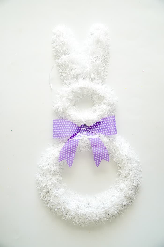 Dollar store Easter Bunny. This Easter Bunny Wreath is the perfect DIY Easter wreath. The flowers are just what your Spring Door Hanger needs. Easter Door Hangers made pretty.