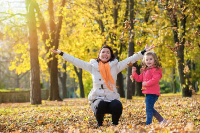 Mom and Child having fun in the fall leaves