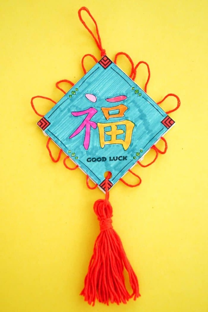 Good Luck Ornaments. Chinese New Year Kids Craft. Free Printable Chinese New Year Craft. Chinese New Year Good Luck Ornament. How to make a good luck ornament. Celebrate the Chinese New Year with these simple crafts. Chinese New Year Crafts.