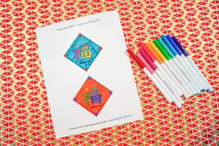 Good Luck in the New Year. Good Luck Ornaments. Chinese New Year Kids Craft. Free Printable Chinese New Year Craft. Chinese New Year Good Luck Ornament. How to make a good luck ornament. Celebrate the Chinese New Year with these simple crafts.
