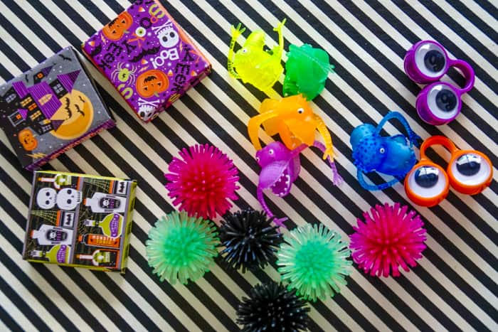 Colorful Boo Bucket Items including Halloween party favors.