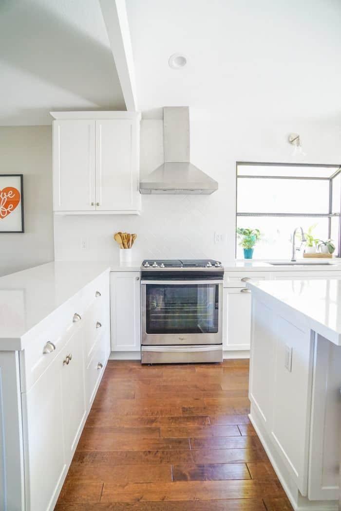 All White Kitchen with harringbone white backsplash. Kitchen renovation. Classic White Kitchen, Modern Farmhouse Style Kitchen. All White Kitchen.