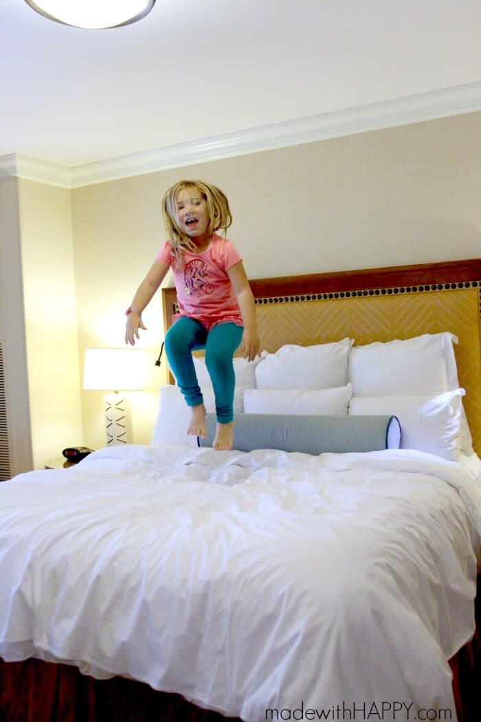 MWHGirl-Jumping-on-bed