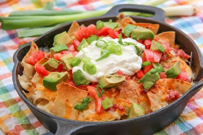 Simple and delicious ingredients to make these Campfire Nachos for your next camping trip or backyard BBQ. Camping Recipes. Simple campfire recipe ideas.