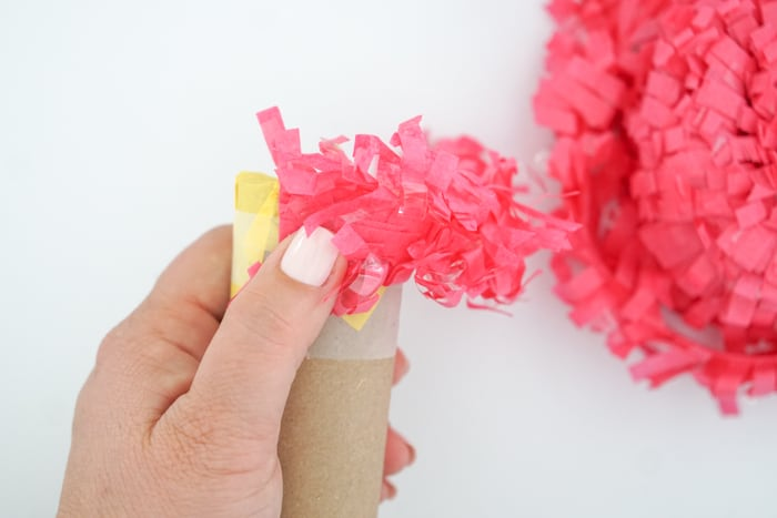 Add fringe to toilet paper roll