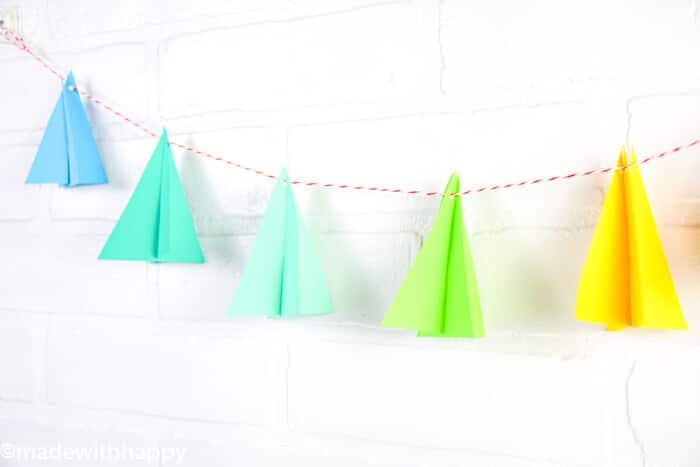 If you're looking for a way to decorate with modern Christmas trees, then we're sharing our simple and colorful tutorial. Paper Crafts for Christmas.  Modern Christmas Tree crafts. Simple Christmas Crafts. Kids Crafts for Christmas.