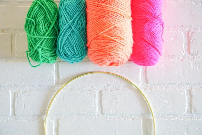 Floral Ring Wall Hanging. Modern Christmas Wreath.  Colorful Wall Hang.  Simple modern Christmas decor. DIY Wall Hang Ideas. Modern Wall Hangs with a lot of color. Colorful Wall Hangs. Christmas wreaths made out of yarn.