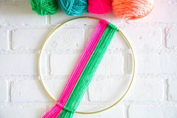 Wall Hangings with Color. Modern Christmas Wreath.  Colorful Wall Hang.  Simple modern Christmas decor. DIY Wall Hang Ideas. Modern Wall Hangs with a lot of color. Colorful Wall Hangs. Christmas wreaths made out of yarn.