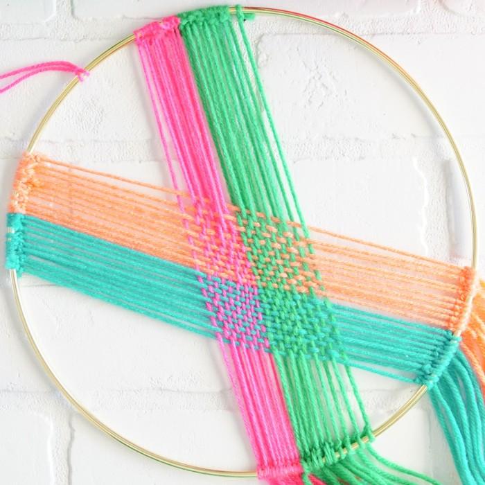 Simple weaving. Modern Christmas Wreath.  Colorful Wall Hang.  Simple modern Christmas decor. DIY Wall Hang Ideas. Modern Wall Hangs with a lot of color. Colorful Wall Hangs. Christmas wreaths made out of yarn.