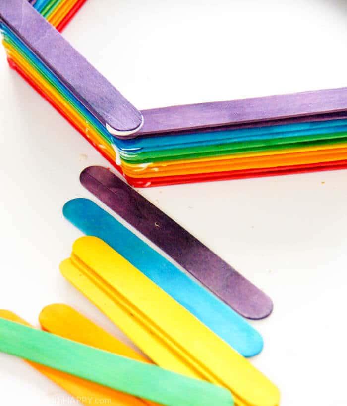 Modern Shelf DIY. Making a small hexagon shelf out of popsicle sticks. Rainbow shelves. Home DIY | Modern Popsicle Shelf | www.madewithhappy.com