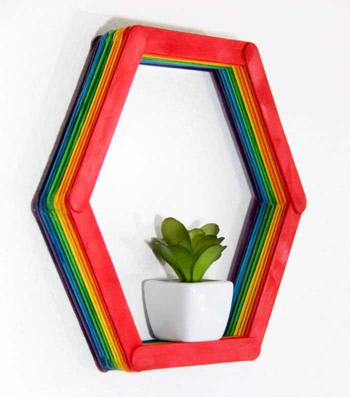 Modern Shelf DIY. Making a small hexagon shelf out of popsicle sticks. Rainbow shelves. Home DIY | Modern Popsicle Shelf | www.madewithhappy.com
