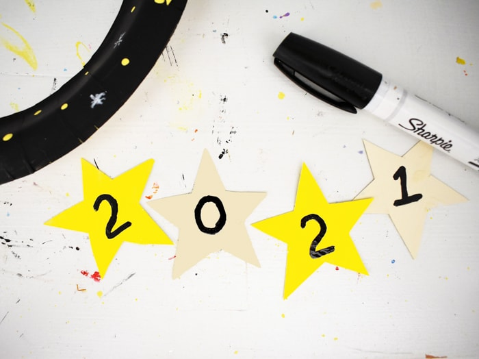a number written on each of four stars to mark the year