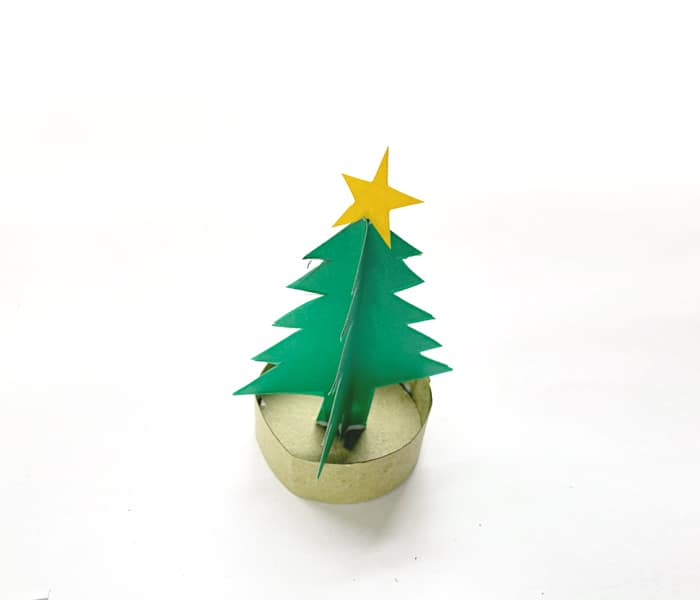 gluing gold star to top of tree