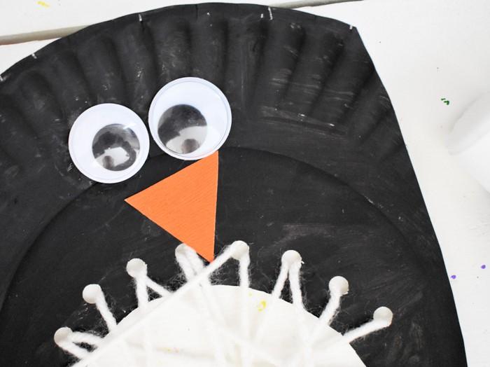 Add orange triangle and googly eyes