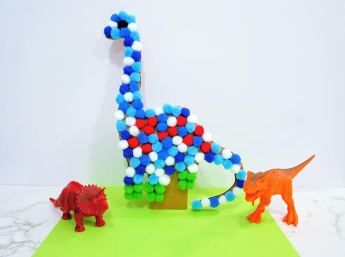 Pom Pom Dinosaur